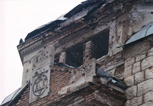 Sarajevo Synagogue with many bullet holes and bomb damage, photo by author.